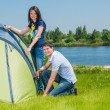 Couple Setting Up Tent — Stock Photo #21711087