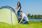 Couple Setting Up Tent — Stock Photo
