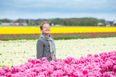 Happy Girl In Tulips — Stock Photo