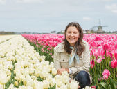 Woman in the tulips field — Stock Photo