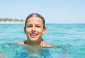 Young girl in the sea — Stockfoto