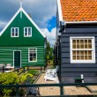 Typical houses in Marken, Netherlands, a small fisherman's town. — Stock Photo #22909432