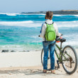 Girl with bike on the beach — Stock Photo