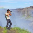 View of woman photographer. Iceland — Stock Photo