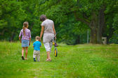 Mother and kids in park — Stock Photo