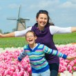 Boy with mother in the tulips field — Stock Photo