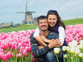 Young couple in the tulip field — Stock Photo