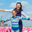 Royalty-Free Stock Photo: Boy with mother in the tulips field