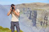 Widok kobiety fotograf. islandia — Zdjęcie stockowe