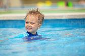 Boy in pool — Stock Photo