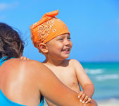 Mother and son having fun beach — Stock Photo