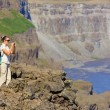 View of woman walking near famous Dettifoss waterfall in Vatnajokull National Park, Northeast Iceland — Stock Photo