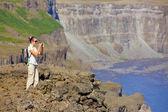 View of woman walking near famous Dettifoss waterfall in Vatnajokull National Park, Northeast Iceland — Stock Photo