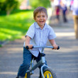 Stock Photo: Little boy on a bicycle