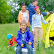 Young boy camping — Stock Photo