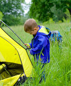 Young boy camping with tent — Stock Photo