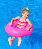 Girl in the pool — Stock Photo