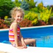 Girl in pool — Stock Photo #26939409