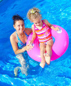 Girl with mother in the pool — Stock Photo