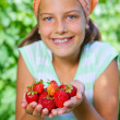Stock Photo: Young girl holding in hand organic natural healthy food produce - strawberries. Vertical view