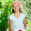 Young girl holding plate with organic natural healthy food produce - strawberries. Vertical view — Stock Photo