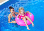 Girl with mother in the pool — Foto de Stock