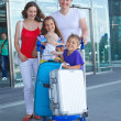 Portrait of traveling family of five with suitcases in airport — Stock Photo