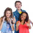 Three young happy teenagers grimacing. Isolated on white background. — Stock Photo