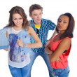 Stock Photo: Three young happy teenagers grimacing. Isolated on white background.
