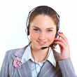 Young business woman with headset — Stock Photo