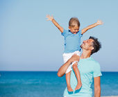Father and son on tropical beach — Stock Photo