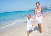 Cute boy and girl on the beach — Stock Photo
