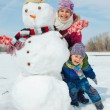 Kids make a snowman — Stock Photo
