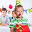Boy with giftbox at birthday party — Stock Photo