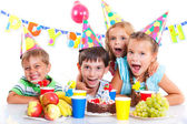 Kids with birthday cake — Stock Photo