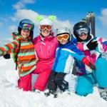 Skiing winter fun. Happy family — Stock Photo #31333471