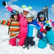 Skiing winter fun. Happy family — Stock Photo #31337939