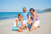 Kids and mother on the beach — ストック写真