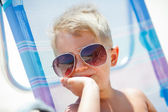 Cute child relaxing on beach — Stock Photo