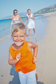 Cute boy with sister and mother on the beach — Stock Photo