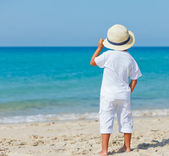 Boy with hat on the beach — Stock Photo