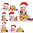 Little boy in Santa's hat with gingerbread house — Stock Photo