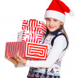 Girl in Santa's hat with gift box — Stok fotoğraf