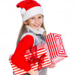 Girl in Santa's hat with gift box — Photo