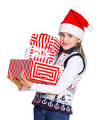 Girl in Santa's hat with gift box — Stock Photo