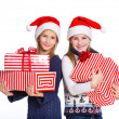 Two girl in Santa's hat with gift box — Stockfoto