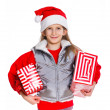 Girl in Santa's hat with gift box — Stockfoto