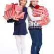 Two girl in Santa's hat with gift box — Стоковая фотография