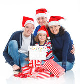 Family in Santa's hat with gift box — Stock Photo