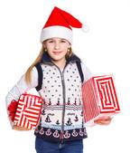 Girl in Santa's hat with gift box — Stock Photo